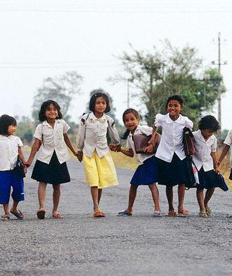 1992, Cambodia --- Children on their way to school, in Sihanoukville. --- Image by © Jose Nicolas/http://www.josenicolas.fr/Corbis